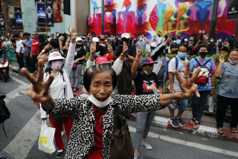 Thai protesters rally in their thousands ahead of parliamentary debate