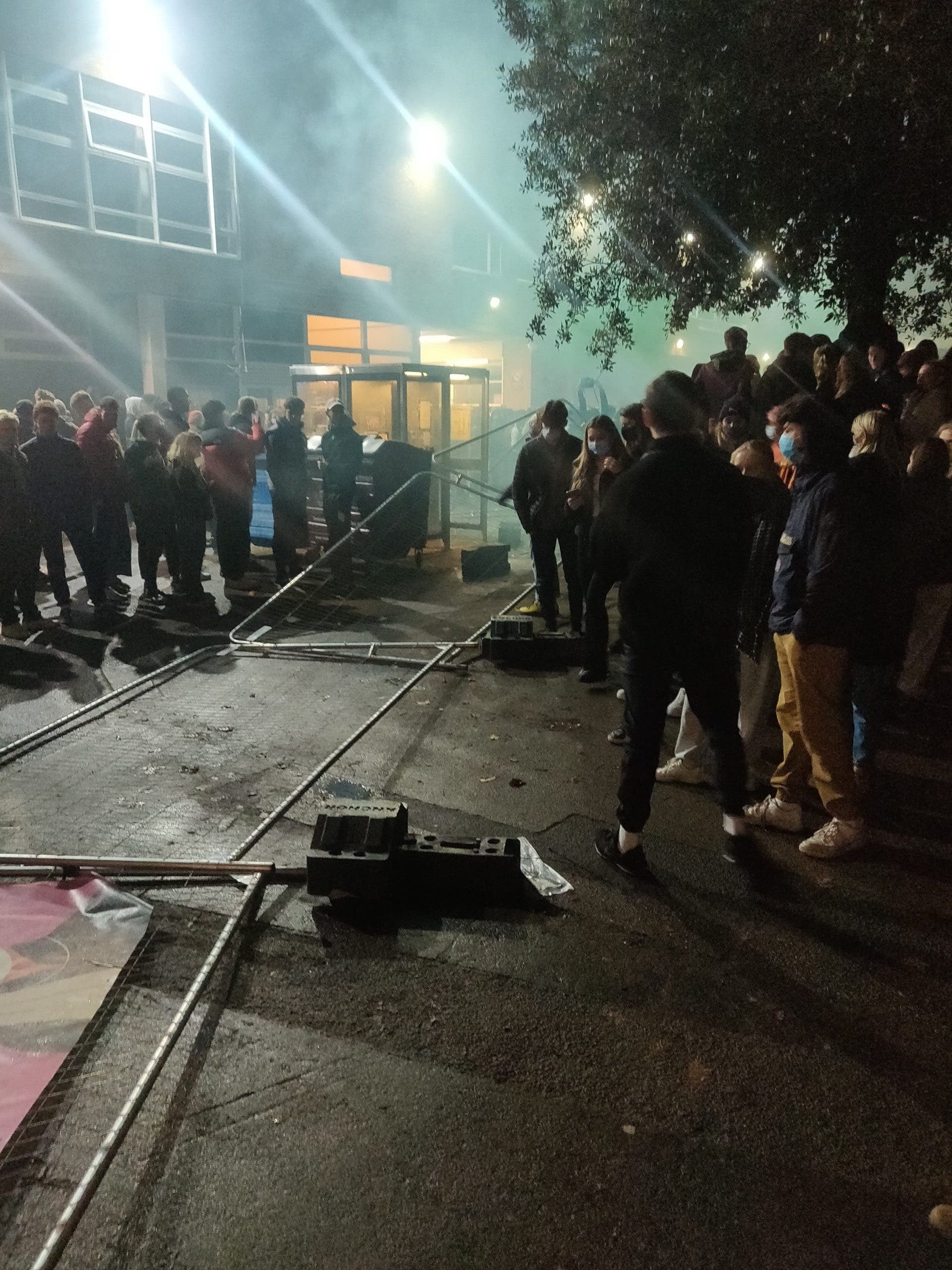 Angry students pull down security fences erected around halls of residence
