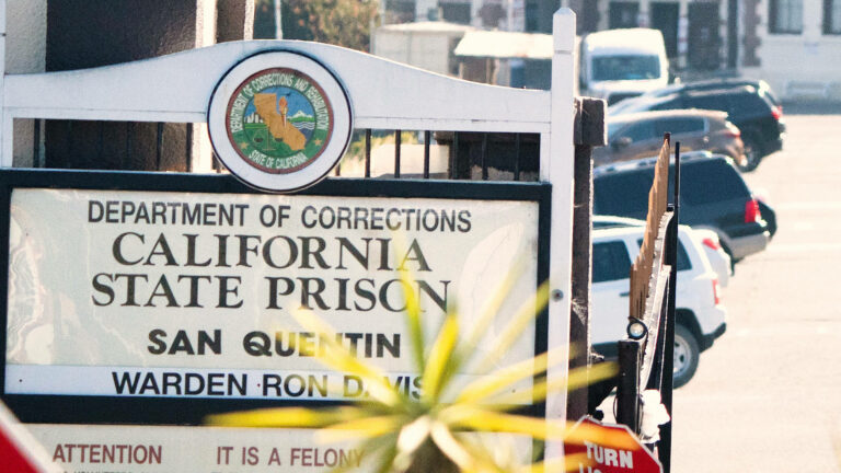 Read more about the article Free Them All: COVID Is Surging in CA Prisons. Why Is San Quentin Transferring 100s of Prisoners?