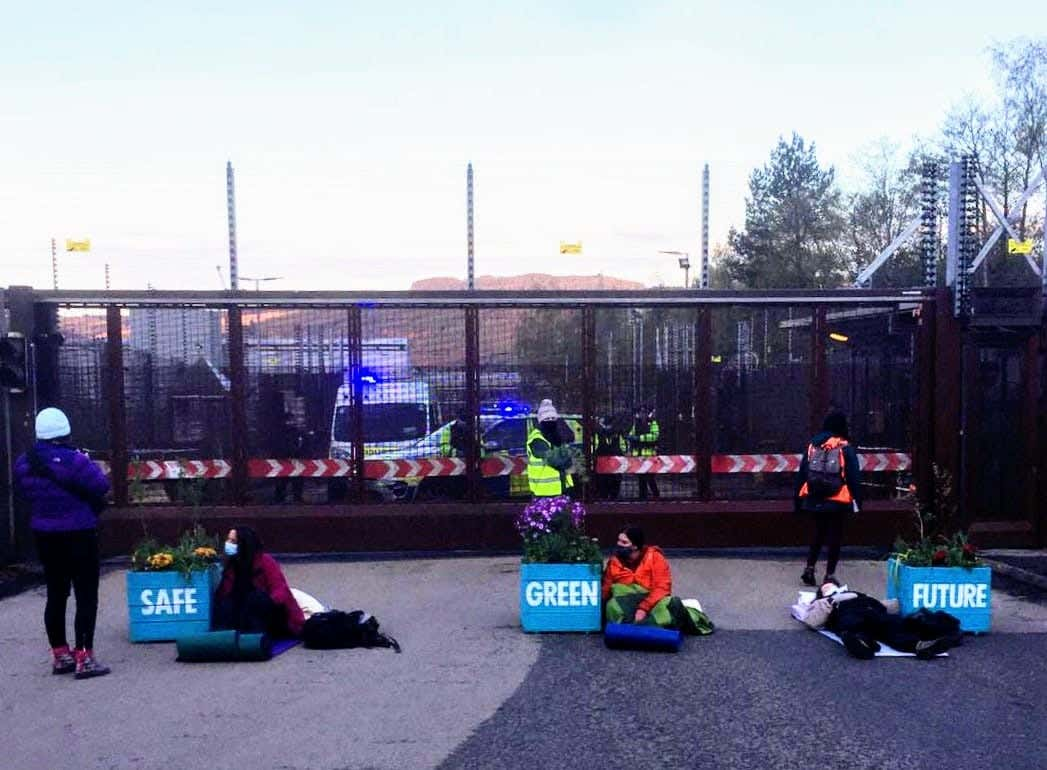 Read more about the article Climate activists blockade nuclear base with giant plant pots