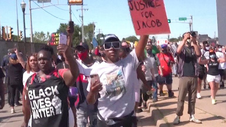 """Read more about the article """"Our Demand Is for Him to Be Fired"""": Outrage in Kenosha as Cop Who Shot Jacob Blake Returns to Work"""